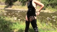 Handcuffs fetish At a river in waders and pvc swimsuit and handcuffs