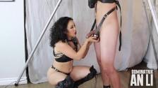 Femdom An Li teasing and ballbusting her bondage slave