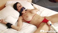 Tied up in lingerie photos Tied-up babe gets pleasured by a toy