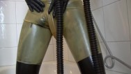 Latex glossary Young latex fetish girl fully rubberized with pisspants and gasmask