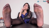 Asian milfs nylons Smokes a cig while her nylon feet are up