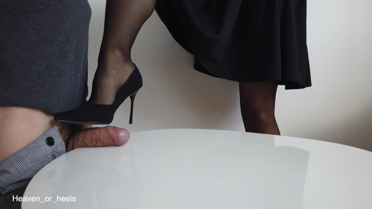 Dominant wife ruins slave's orgasm with a stocking footjob ▶5:04