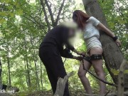 The photographer tied a woman in the forest for nude photos
