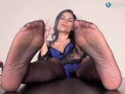 Sexy brunette smokes with feet up