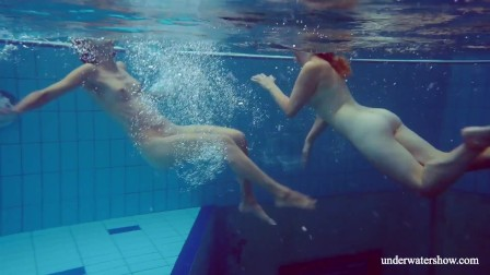 Hottest teens Melisa and Marusia swimming in the pool